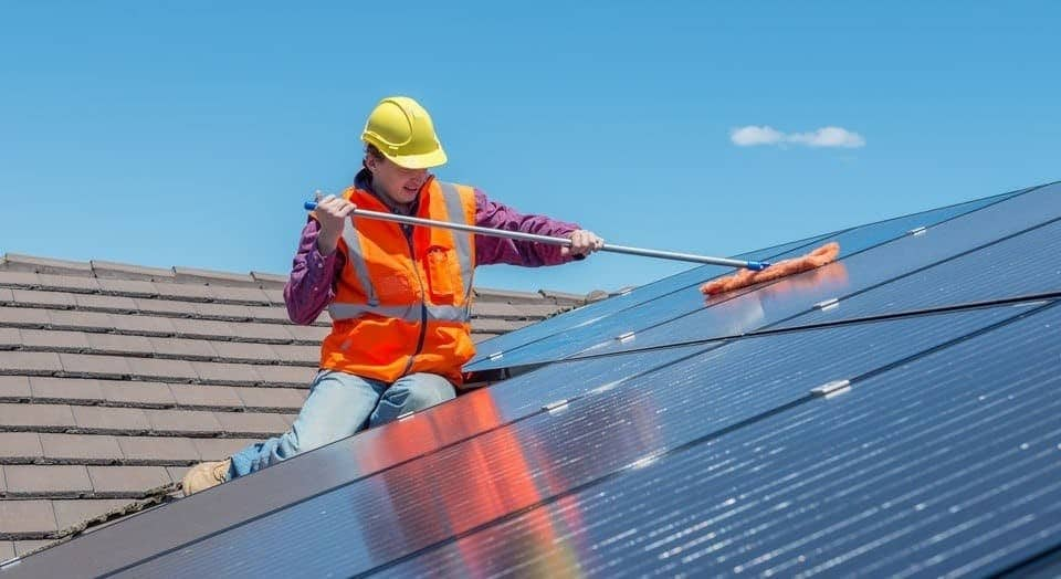 man showing you how to clean solar panels